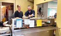 General Manager Brandon Caldwell, right, volunteers at the Lenoir Soup Kitchen.