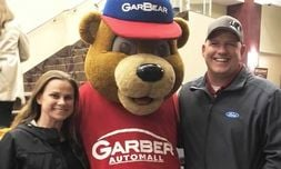 Service Director Paul Bobo and his wife, Melissa, attend a community event with GarBear.