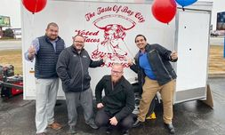 From left, salesmen Ryan Meissner, Lynn Staudacher, Mitch Oeming and Christian Contreras attend Garber Chevrolet Linwood's food truck lunch for employees and customers.