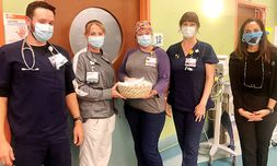 Mikaela Aull, right, drops off cookies to nurses at Novant Health.
