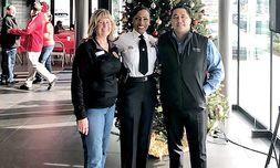 Durham Police Chief C.J. Davis with General Manager Dean Perella and sales team member Vicki Basting.