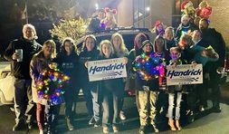 The team at the finish line of the Easley Christmas parade with one of its 12 decorated vehicles