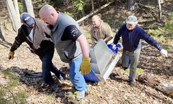 Sales Associate Corey Creteau, foreground, heard about illegal dumping in town and coordinated a cleanup effort in less than 24 hours — on Mother's Day. With him are Sales Associate Ian O'Brien, back left, and two friends.