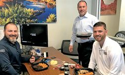 Military Veteran Employee Luncheon: Finance Managers Billy Phister, left, and John Rohde, standing, and Assistant Sales Manager Connor Piecuch