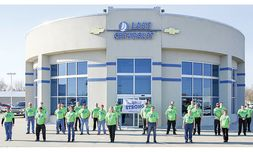 The dealership staff shows support for North Iowa Strong, a fundraiser for struggling businesses.