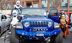 Members of the 501st Legion, Georgia Garrison, a charity group made up of Star Wars fans, aboard one of the dealership's Jeep Wranglers