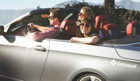 People riding in convertible from car-sharing startup Getaround