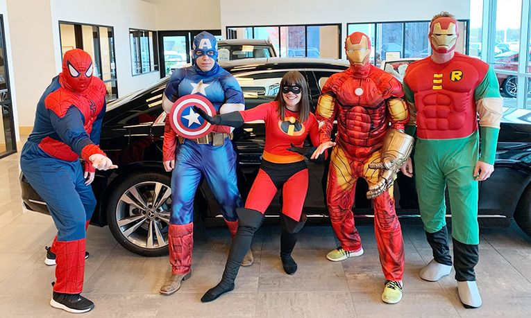 Bergstrom BMW-Mercedes-Benz staff dress as superheroes for Halloween.