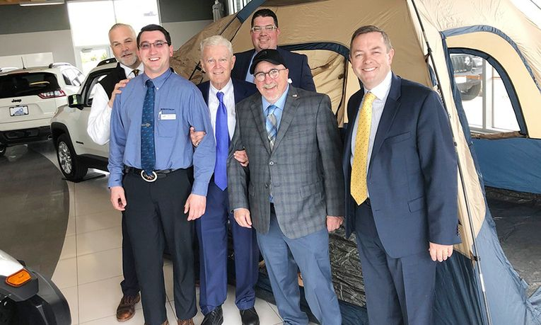 CEO John Bergstrom, third from left, and Executive Vice President John Hogerty II, right, visit Bergstrom Chrysler-Dodge-Jeep-Ram-Fiat of Kaukauna for Race Shop Clean Day, when leaders tour Bergstrom dealerships to inspect their cleanliness and thank the teams.