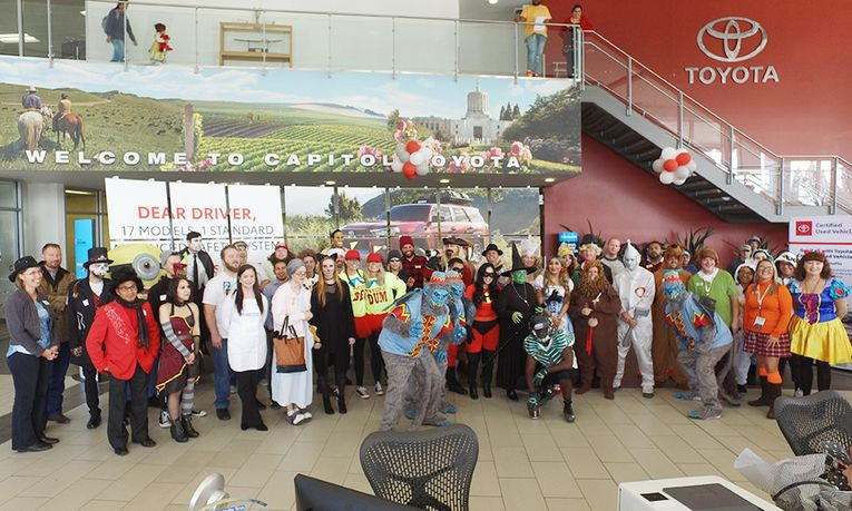 Staff members enjoy the annual Halloween costume contest, now in its 33rd year.