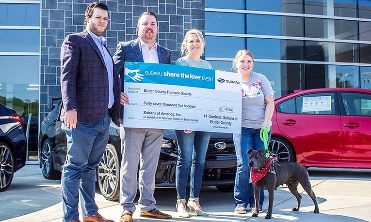 General Sales Manager Michael McGlumphy, second from left, presents a check to members of the Butler County Humane Society as part of Subaru's Share the Love event.