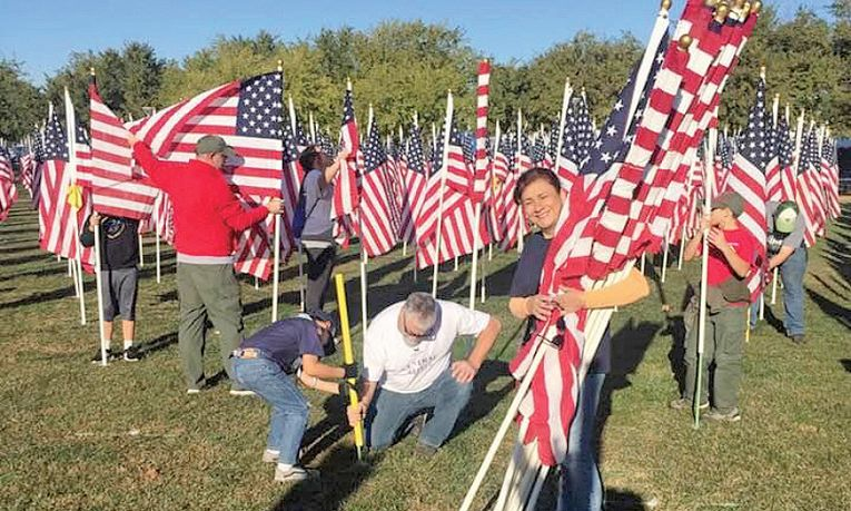 Employees helped put up 2,000 U.S. flags for the Rotary Club of Murrieta's annual Veterans Day Field of Honor.