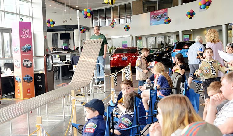 The dealership hosts the annual Boy Scouts Pinewood Derby, providing all participants with patches and the winners with trophies.