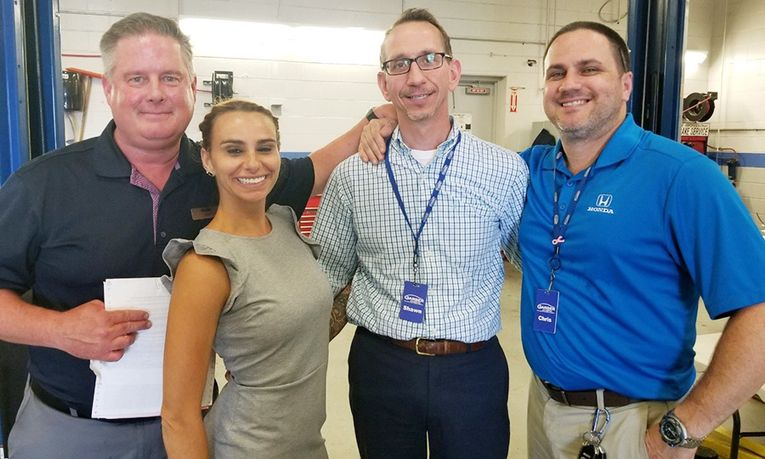 From left, Todd Trask, service manager, Shauna Lauricella, marketing manager, Shawn Brady, Internet manager, and Chris York, parts manager, at a retirement party and employee luncheon