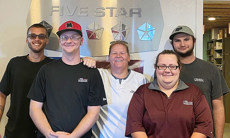 From left, Mitchell Moles, inventory manager; Rory Robbins, technician; Rachel Robbins, service and parts manager; Katia Albert, parts adviser; and Justin Grier, technician