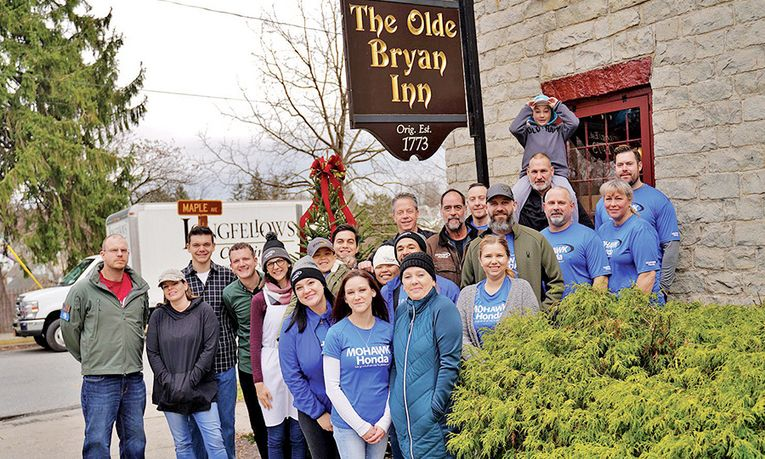 Every Thanksgiving, Mohawk Honda employees deliver meals to the needy prepared by The Olde Bryan Inn.