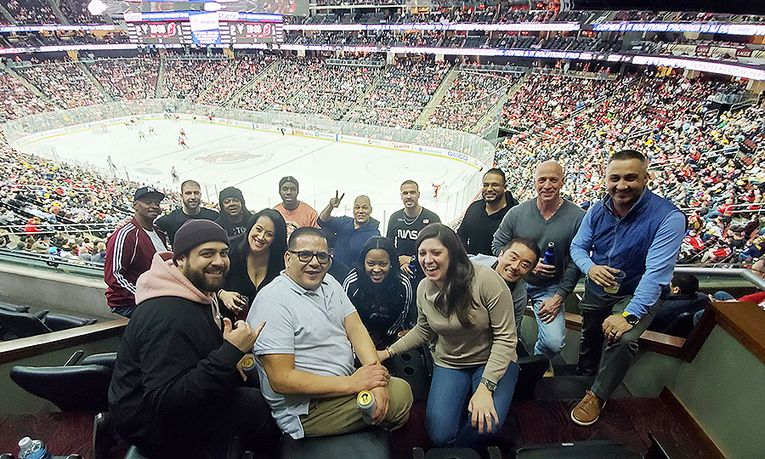 "Team members enjoy the ""suite"" life at a New Jersey Devils game."
