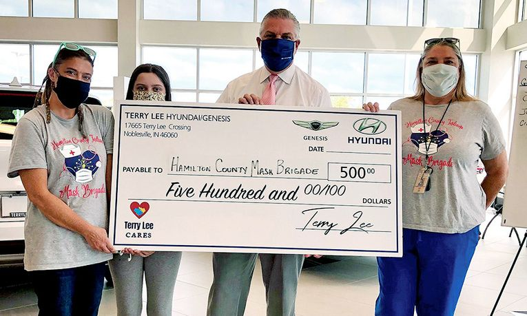 General Manager Jim Smith presents a check to the Hamilton County Indiana Mask Brigade as part of the Terry Lee Cares program.