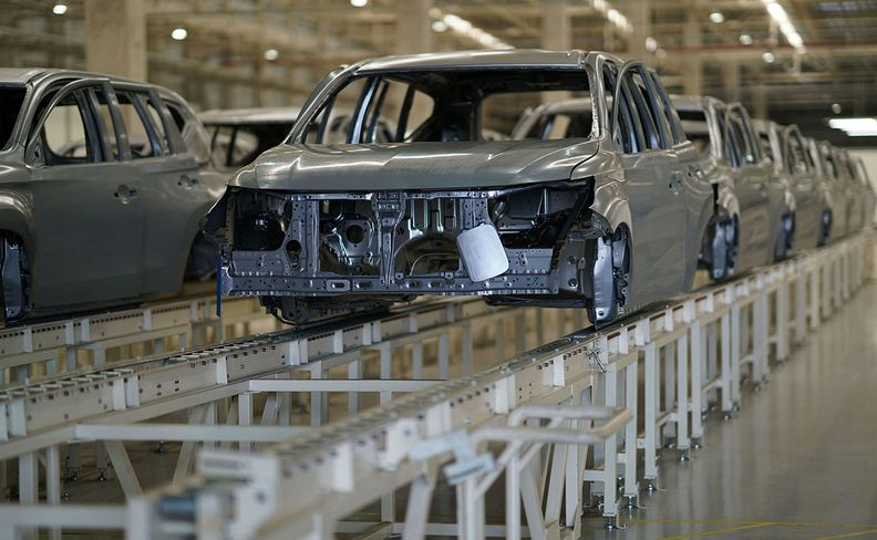 Vehicles moving down assembly line