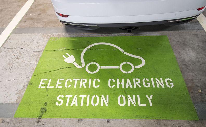 An EV charging sign