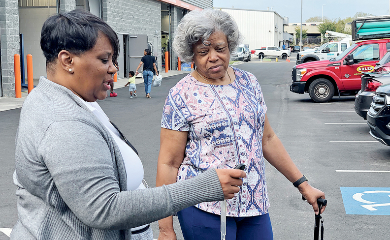 A good rapport with sales rep Crista McMullen, left, motivated Gloria Adams to buy at Hennessy, despite the construction.