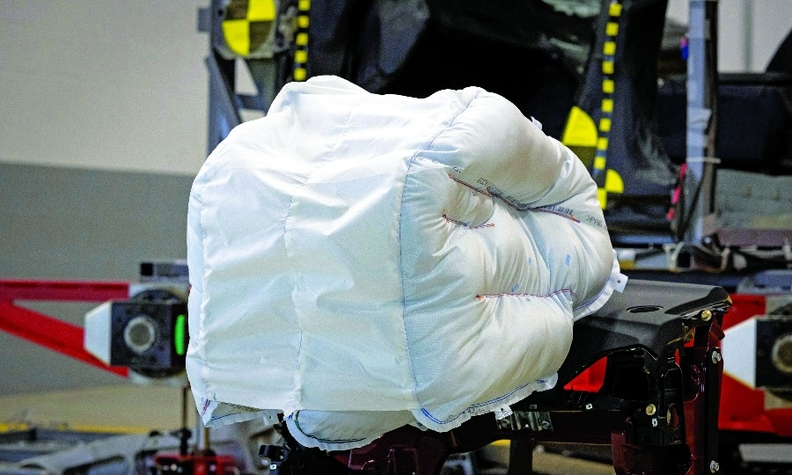 The front airbag has a sail-like panel that cradles the person during impact, slowing movement of the head and bracing it from the sides.
