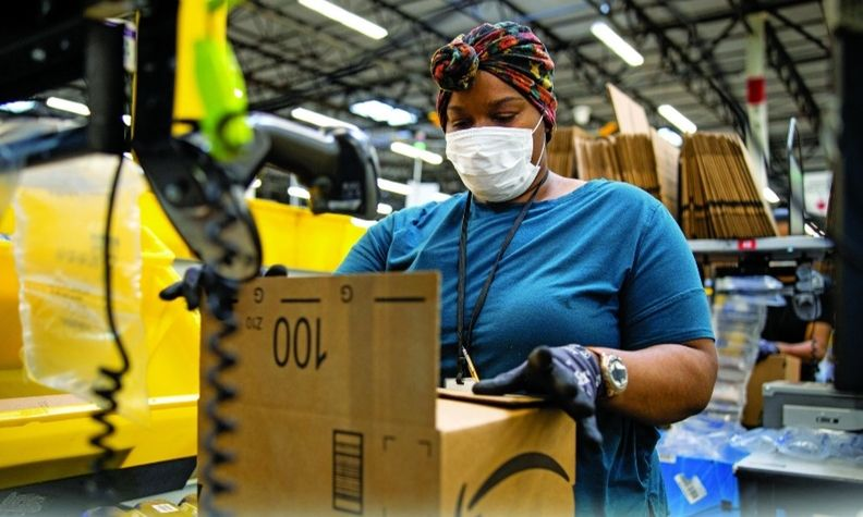 Automotive companies are competing with Amazon, shown, and other large gig economy employers for workers.