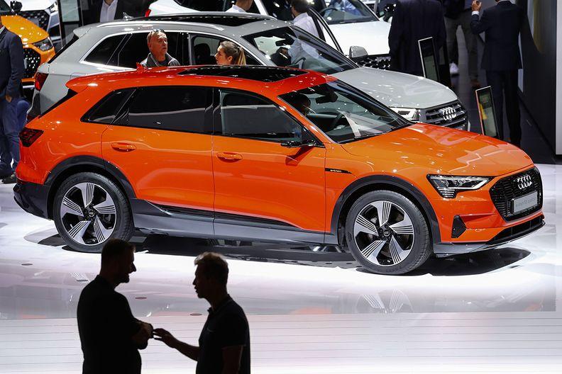 An Audi E-tron displayed at an auto show