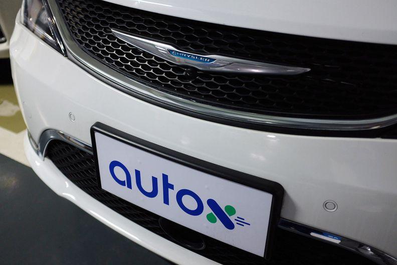 Front of AutoX autonomous Chrysler Pacifica minivan