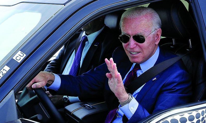 Joe Biden driving EV