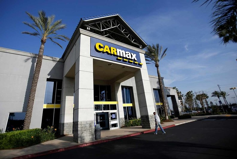 A man walks into a CarMax location