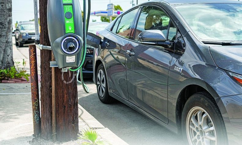 Los Angeles' mobility plan to add more utility pole-mounted, above, and streetlight chargers — such as Blink Charging's IQ 200 unit, below — is part of a push to increase the number of zero-emission vehicles.