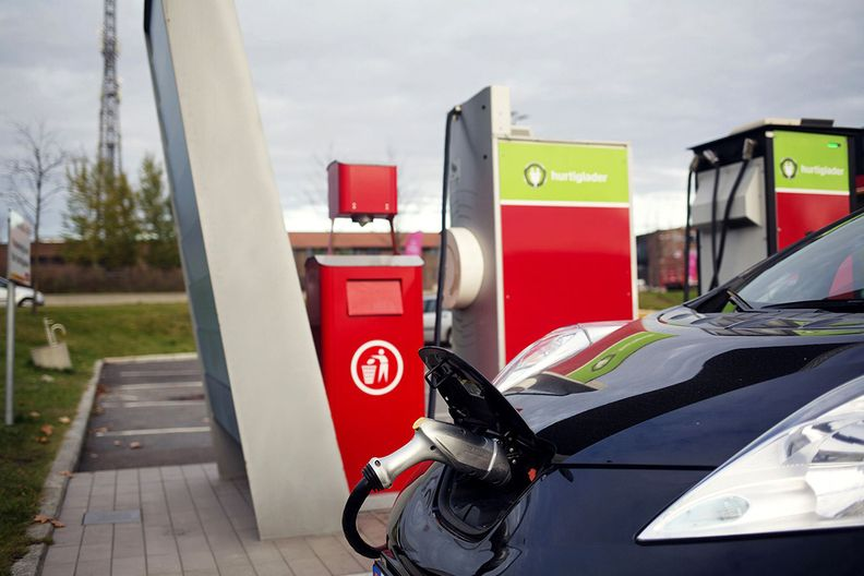 An electric vehicle charges at a 'fast charging' point at a Circle K gas station in Norway, operated by Canada's Alimentation Couche-Tard Inc.