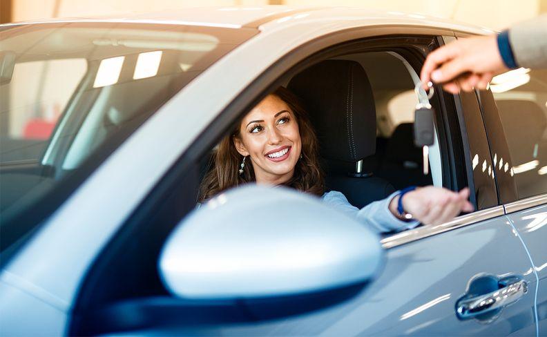 Woman at a car dealership