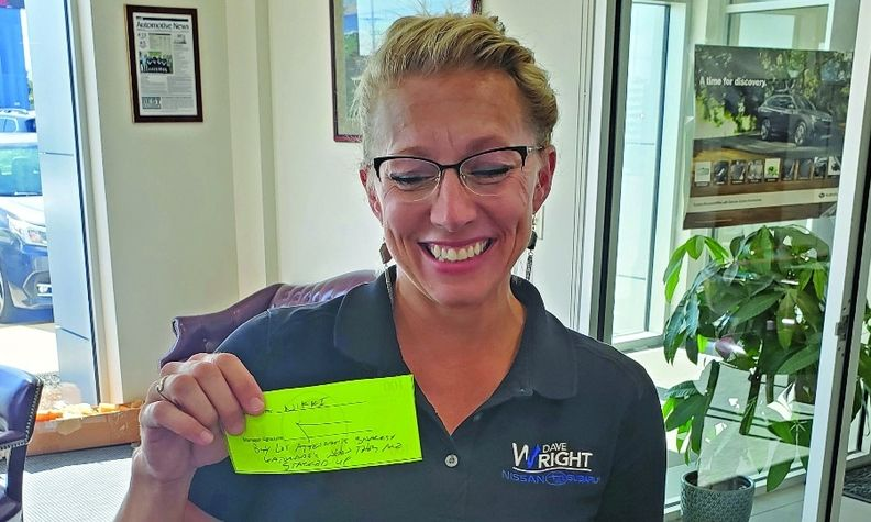 Sales Consultant Nikki Elledge won a Dave Buck for bringing in snacks and drinks for lot attendants.