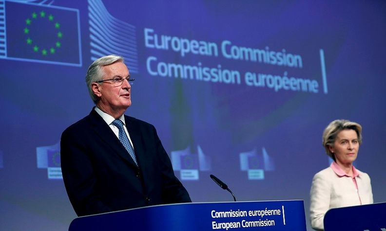 The EU's chief Brexit negotiator, Michel Barnier, gives a statement on the outcome of the Brexit negotiations next to European Commission President Ursula von der Leyen, in Brussels.