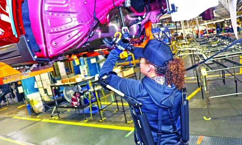 A General Motors line worker wears a passive shoulder exoskeleton on the line at Orion Assembly Plant north of Detroit.