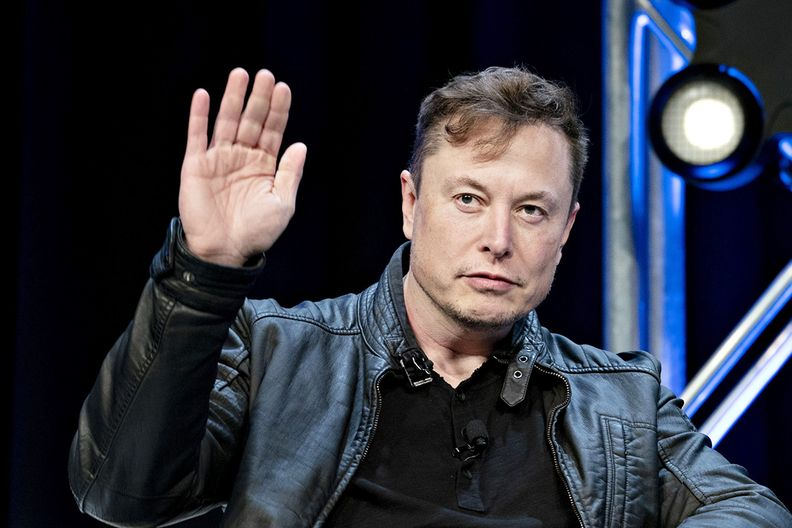 Tesla CEO Elon Musk waving