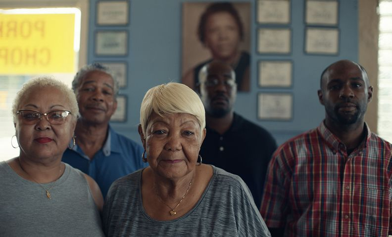 "A group of volunteers in the Ford ""Builders"" TV spot"