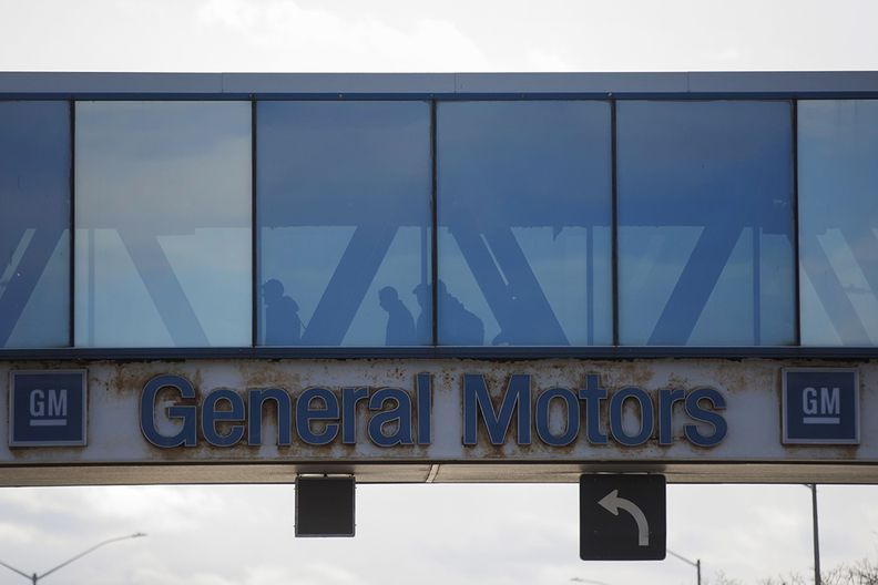 Pedestrian bridge with General Motors sign