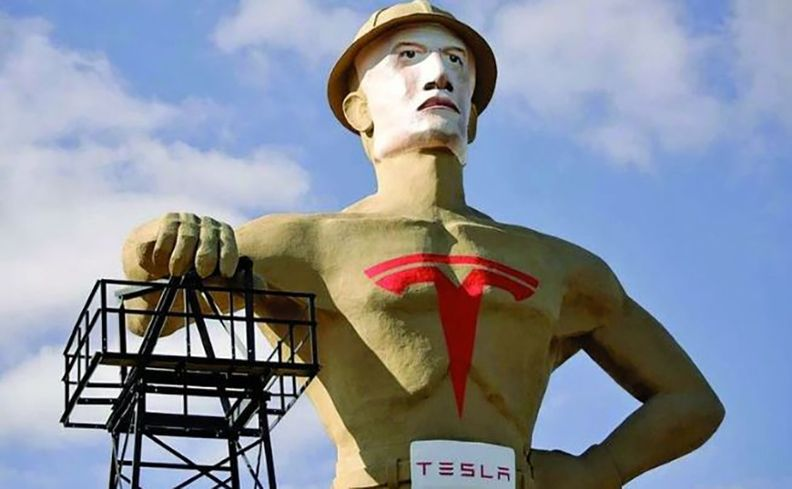 Tulsa's Golden Driller statue with a Tesla logo added