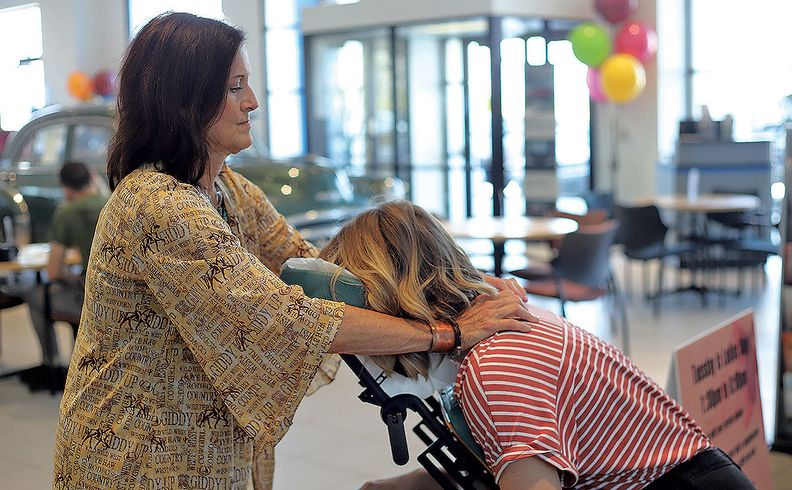 Complimentary massages and manicures are part of the Don Hattan Dealerships promotion.