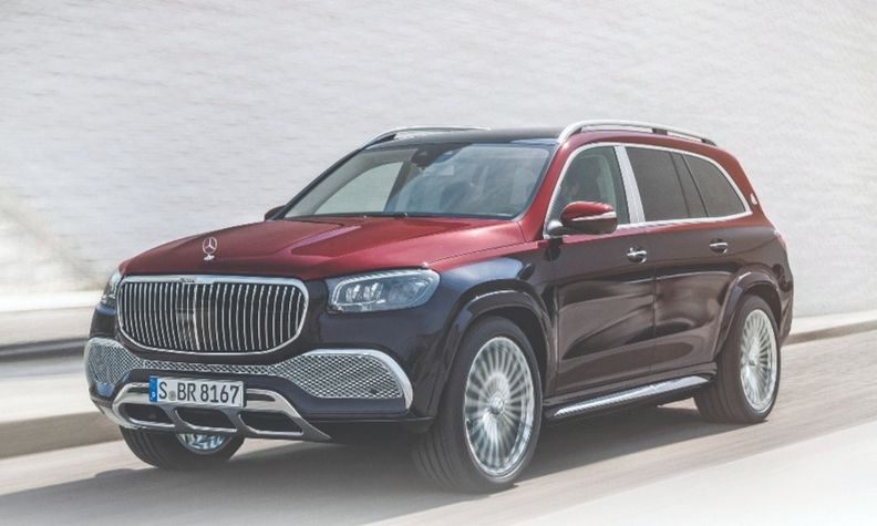 The Mercedes-Maybach GLS exterior features an exclusive grille with vertical louvers and chrome trim elements.