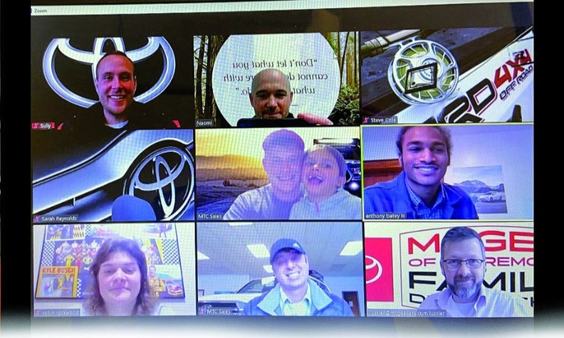 Salespeople at McGee Toyota in Claremont, N.H., communicate through a continuously streamed Zoom meeting.