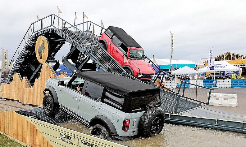 Ford Bronco SUVs tackle an off-road track during Motor Bella.