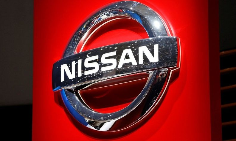 Nissan badge with red background