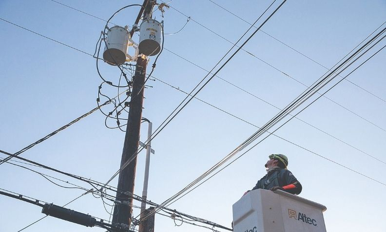 A worker fixes a power line in Austin, Texas, last month.