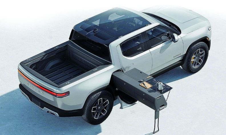 The Rivian R1T's $5,000 slide-out Camp Kitchen includes a heated cooking surface, water tank, collapsible sink and even a coffee grinder.