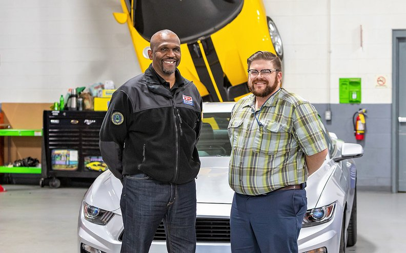 Roush's John Gardner, left, recruited Coast Guard veteran Joshua Kapusta over the summer. Kapusta is assigned to Ford and is working on a future internal combustion engine.