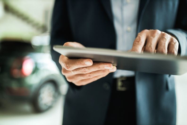 Salesperson using tablet
